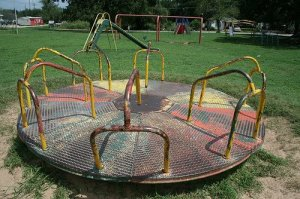 Playground old fashioned merry go round